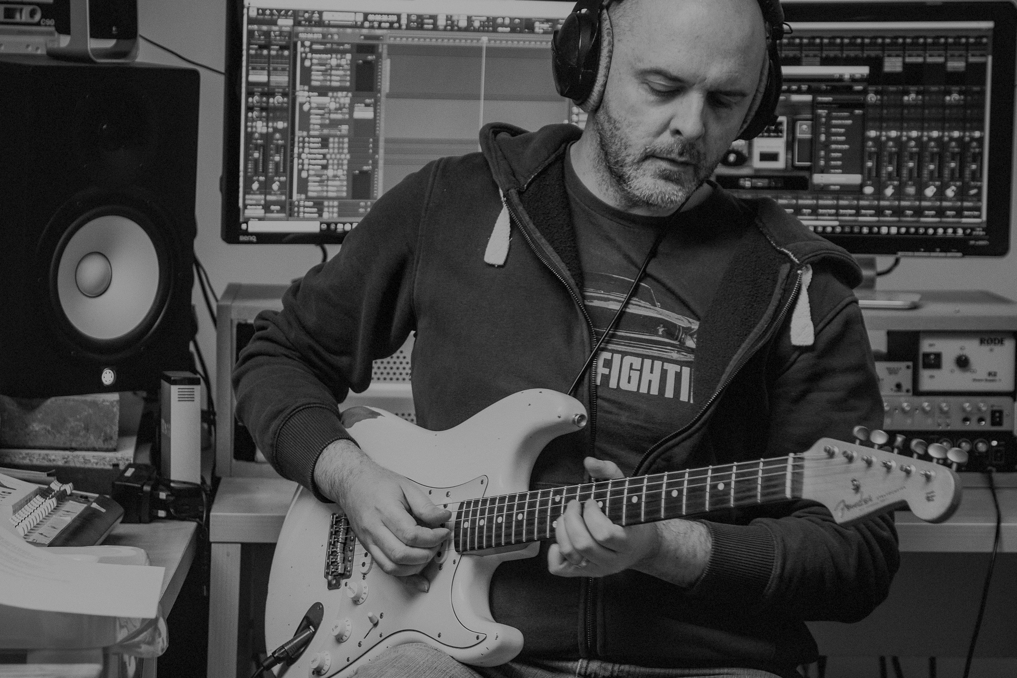 Mark Pierce playing strat in studio