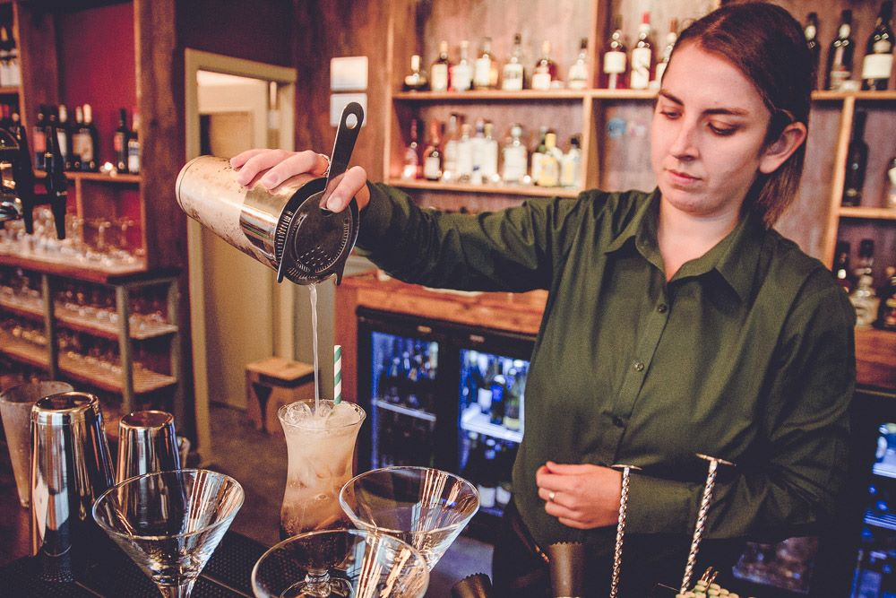 Sheldons Wine Bar Colwyn Bay - bar staff making a cocktail