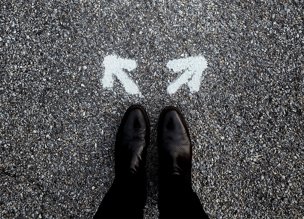 The Next Right thing - picture of feet standing next to arrows pointing different directions